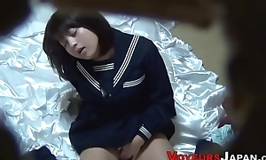 Uniformed asian babe rubs