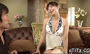 Japanese chick fondles her gut while toying her cunt