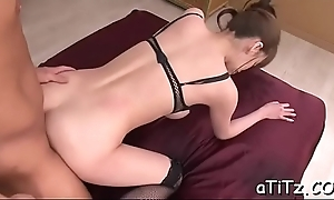 Herculean tits asian stimulates her slit with lusty insertions