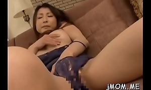 Frightening mature acquires on her knees and gives sexy oral