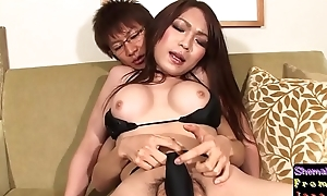 Bikini ladyboy reaches around during sex