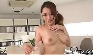 Massive tits asian stimulates her muddy crack with lusty insertions