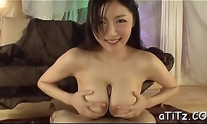 Cute asian with sexy tits stimulates with wicked blowjob