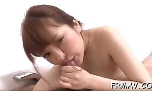 Pretty oriental gets lusty slit toying while engulfing horseshit