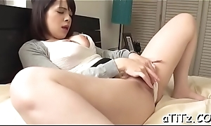 Big milk shakes japanese stimulates her cunt with powerful toys