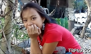 Thai sex doll in a sex act