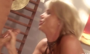 Blonde whore with bubbly tits receives fucked hard on be passed on table
