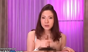 Busty Japanese shows how to tit fuck